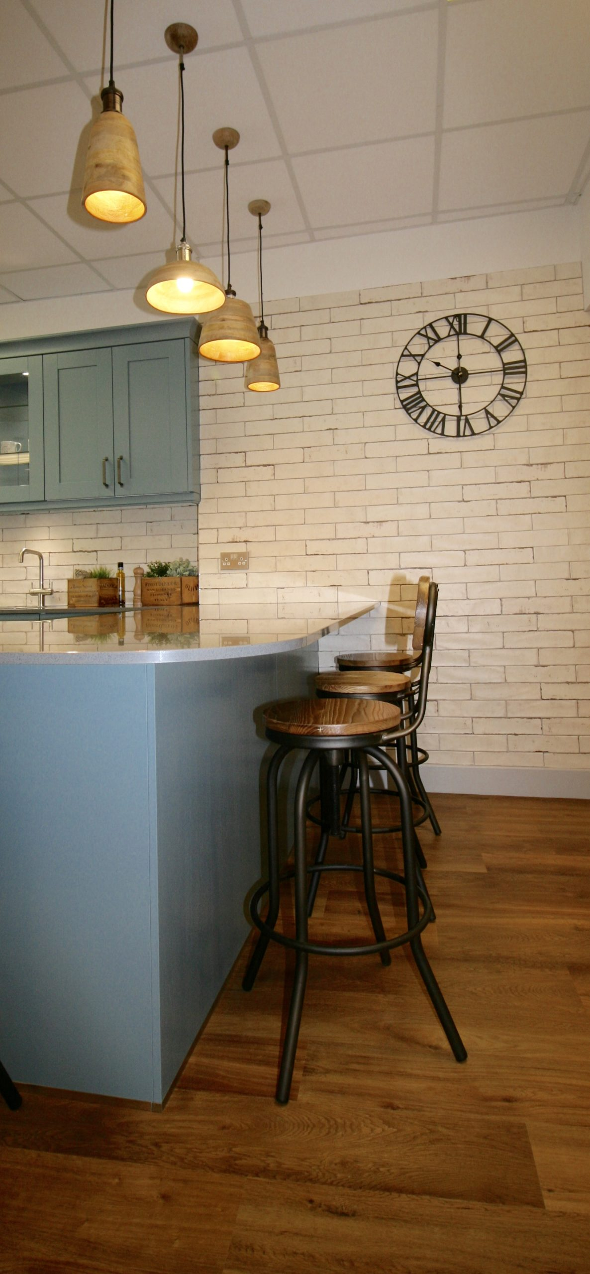 A mixture of vintage and industrial tiles, lighting, seating and accessories