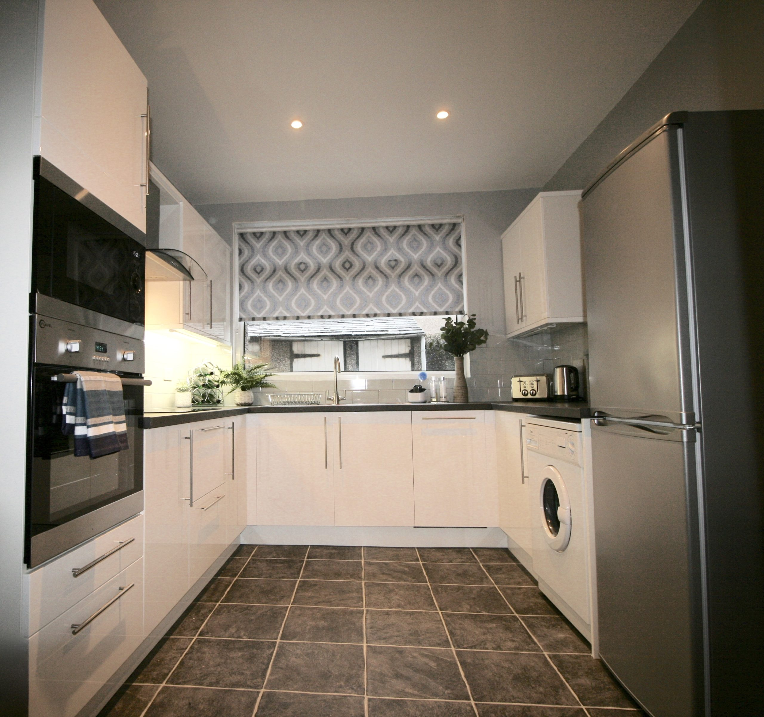 Kitchen Transformation - Affordable contemporary white gloss porter kitchen by PWS fitted by Cockermouth Kitchen Co and designed by Amelia Wilson Interiors Ltd