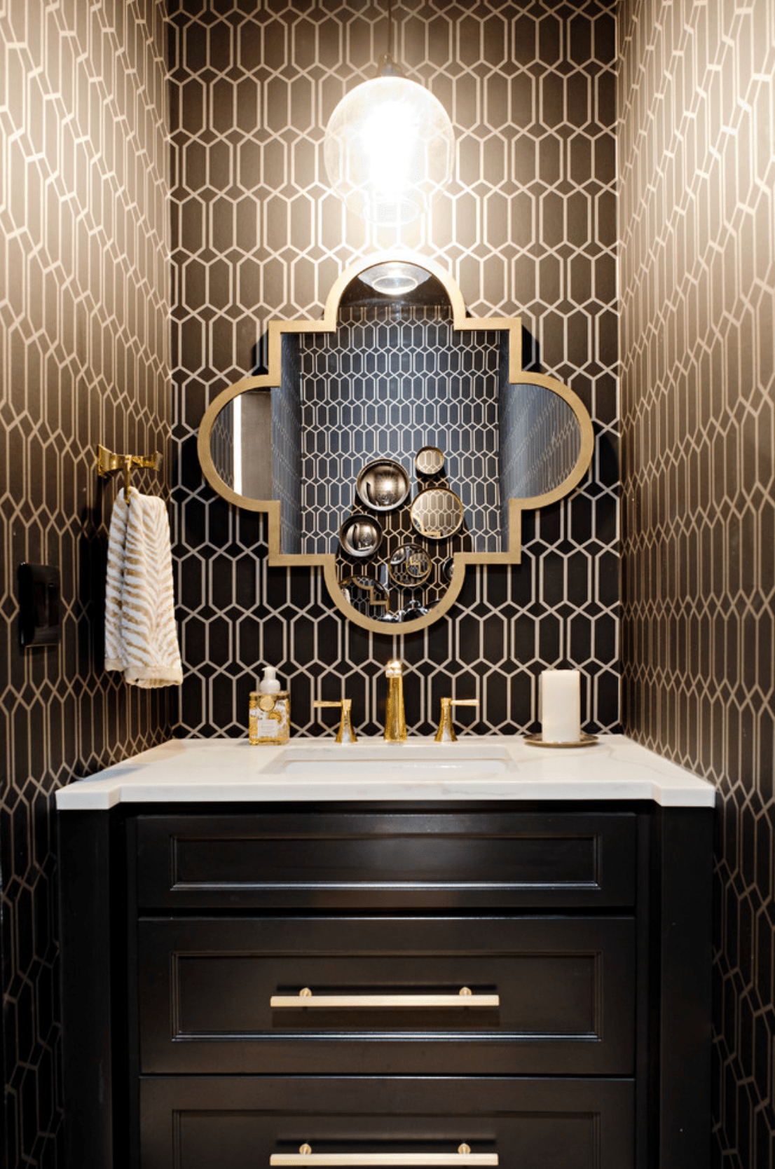 Cloakroom decorated in black and gold