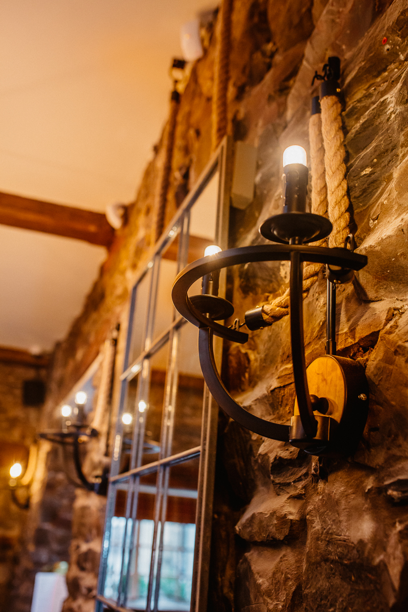 Industrial mirrors and lighting in the restaurant at The Mill at Ulverston gastropub in Cumbria interior design by Amelia Wilson Interiors Ltd