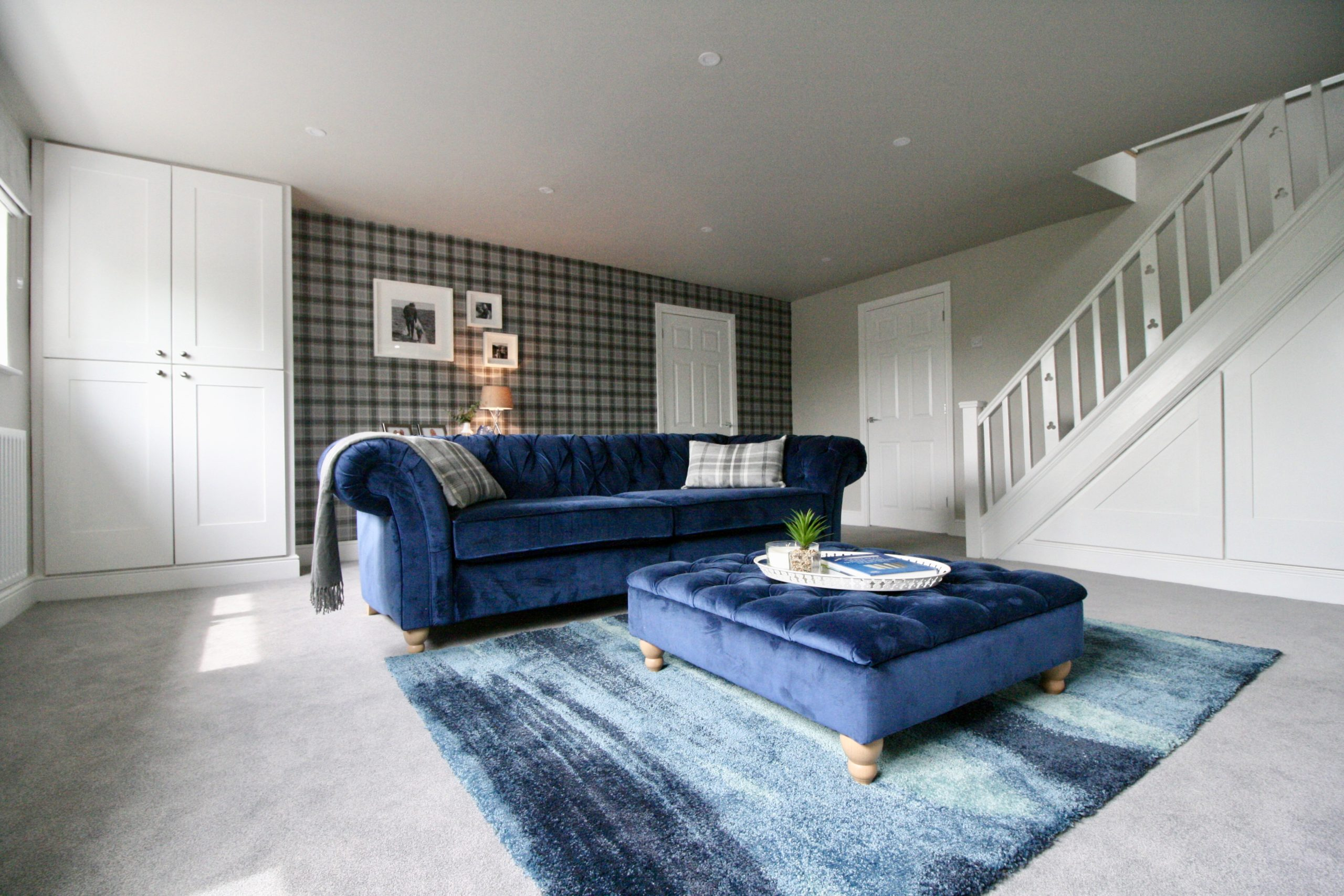 Grey tartan wallpaper grey walls and white woodwork in modern country style TV media room