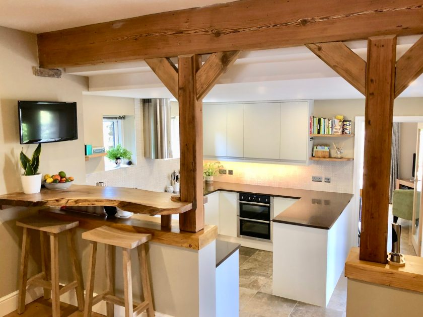 Contemporary open plan kitchen dining space with rustic oak features