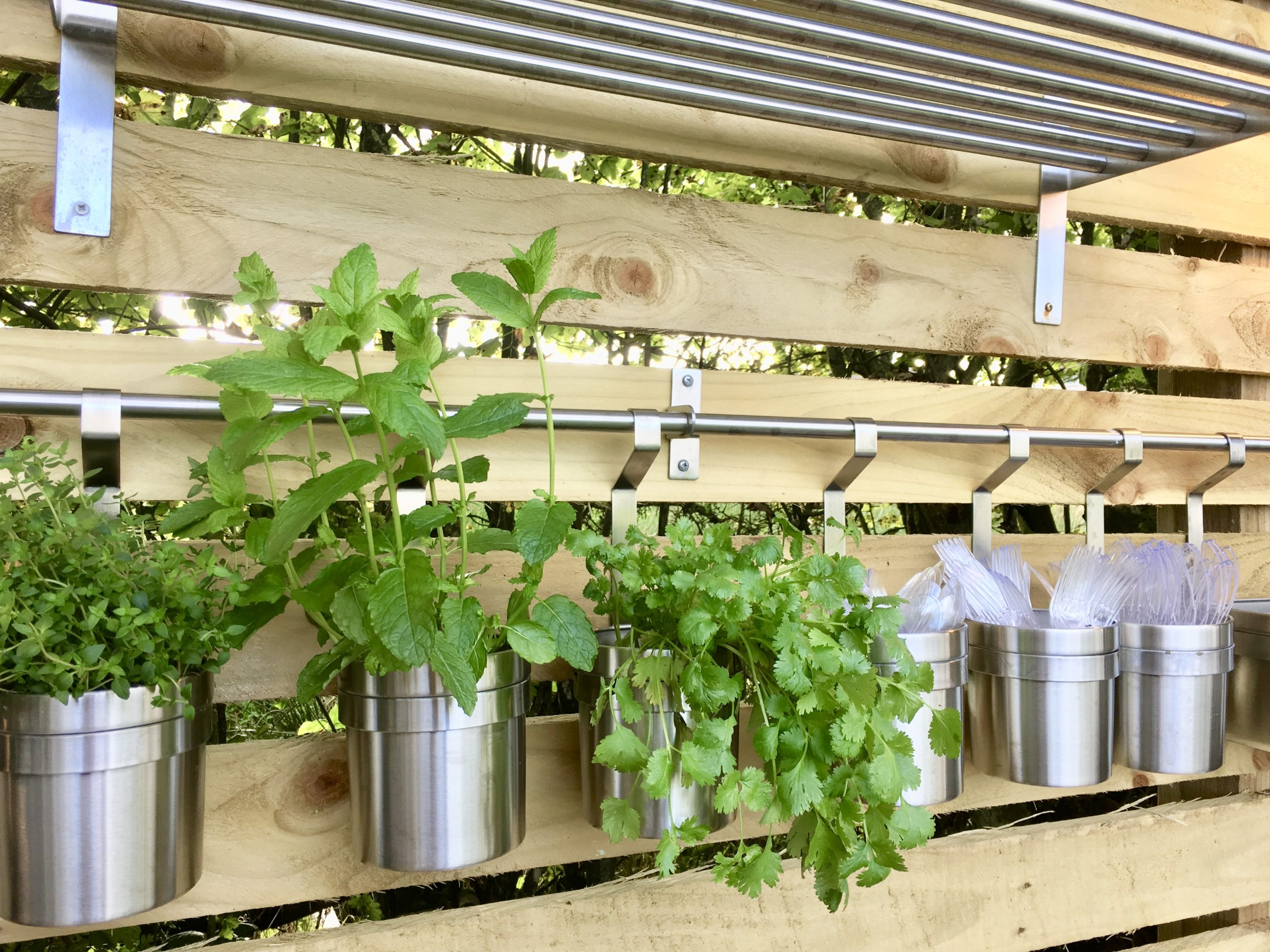 Hanging herb pots from IKEA in outdoor kitchen