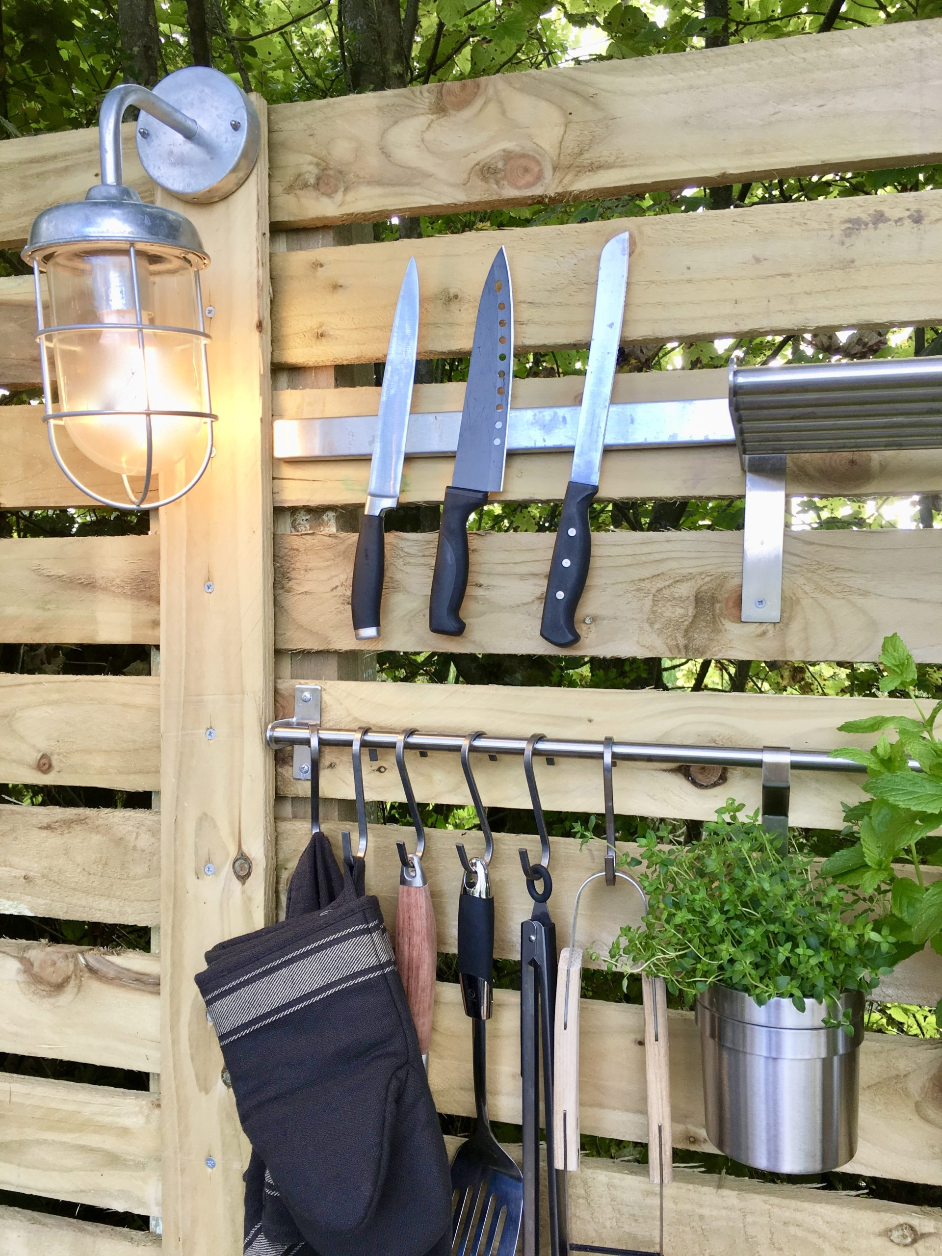Utensil holders in outdoor kitchen