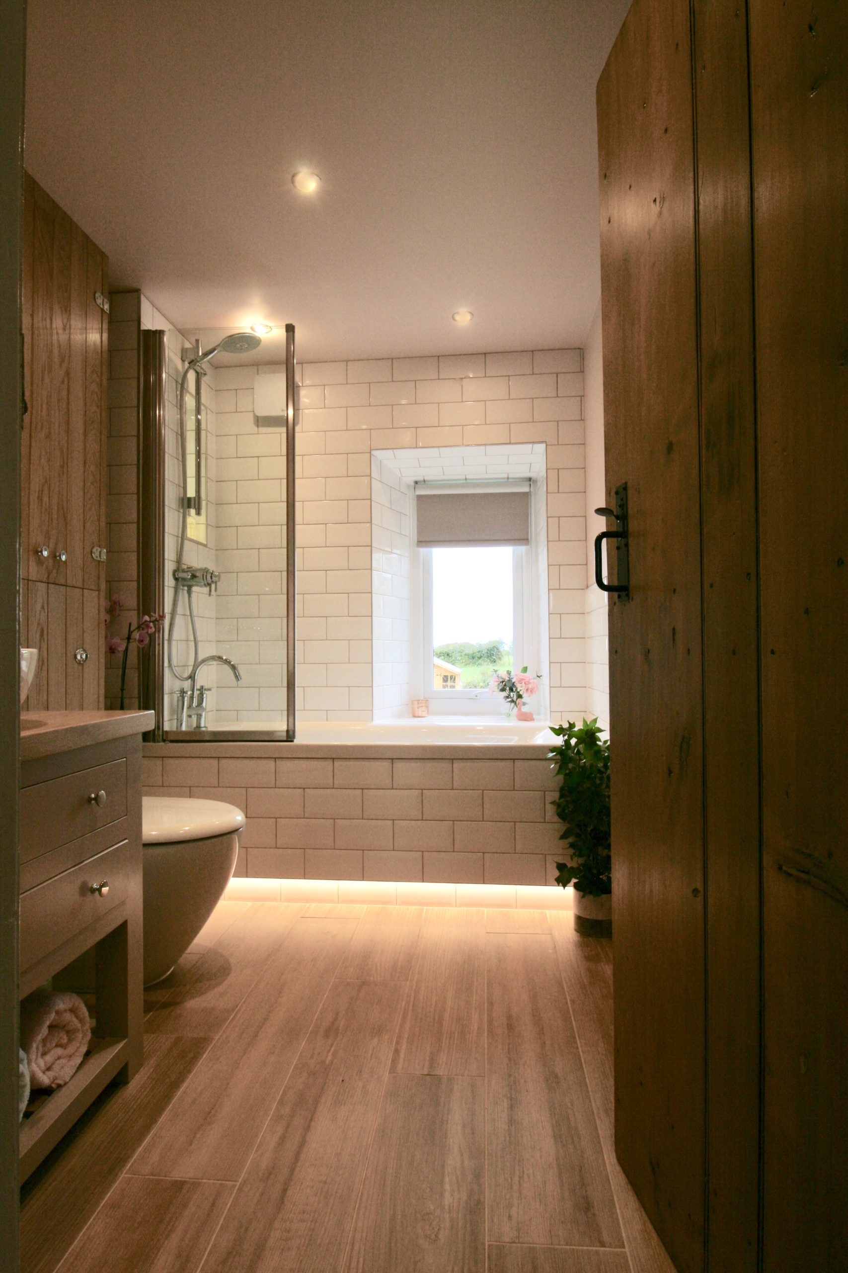Bathrooms - Over bath shower with white metro tiles and pebble grout from Topps tiles by Amelia Wilson Interiors Ltd