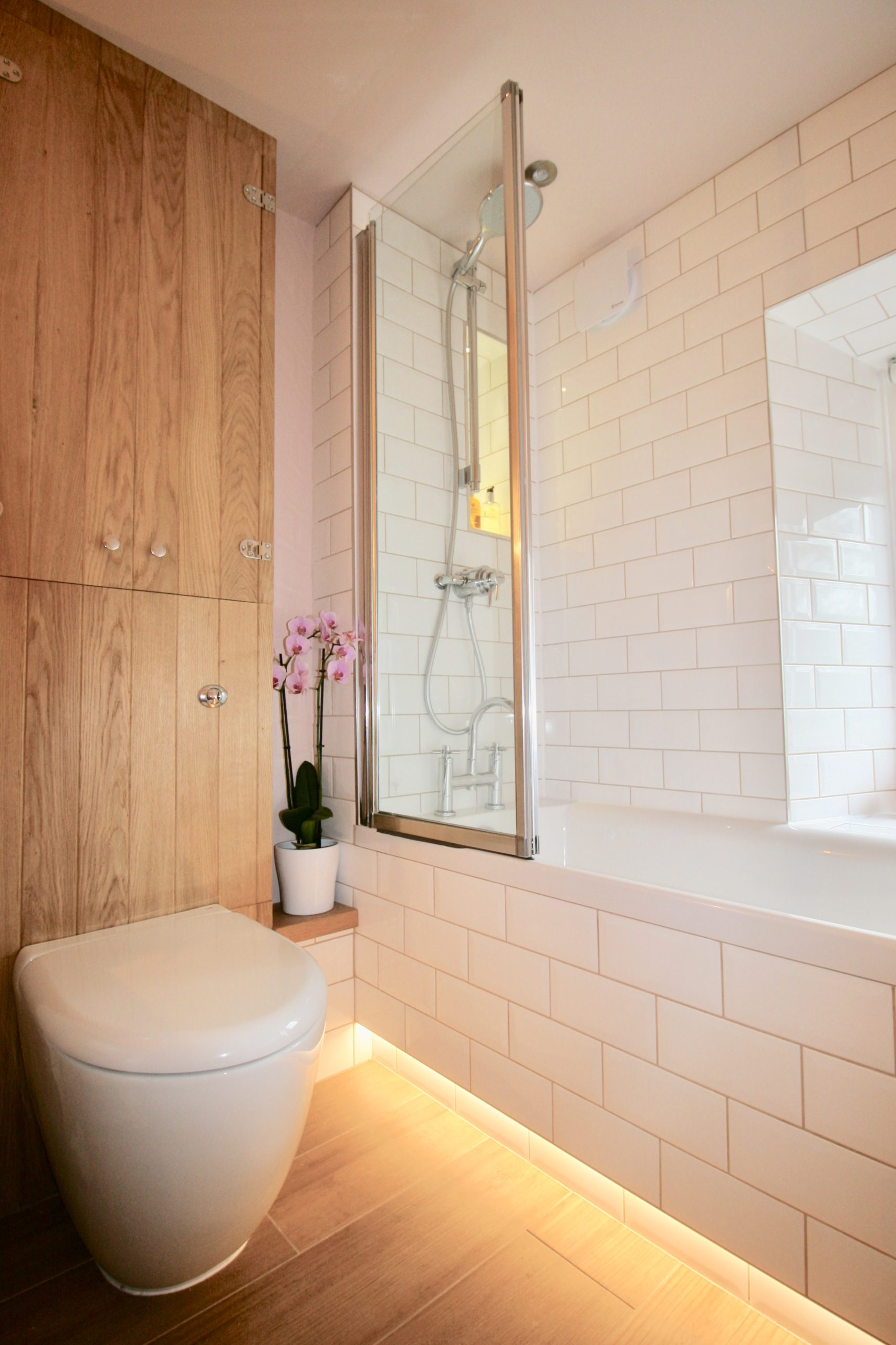 Bathrooms - Grohe 160mm shower riser kit and bifold shower screen in bathroom designed by Amelia Wilson Interiors