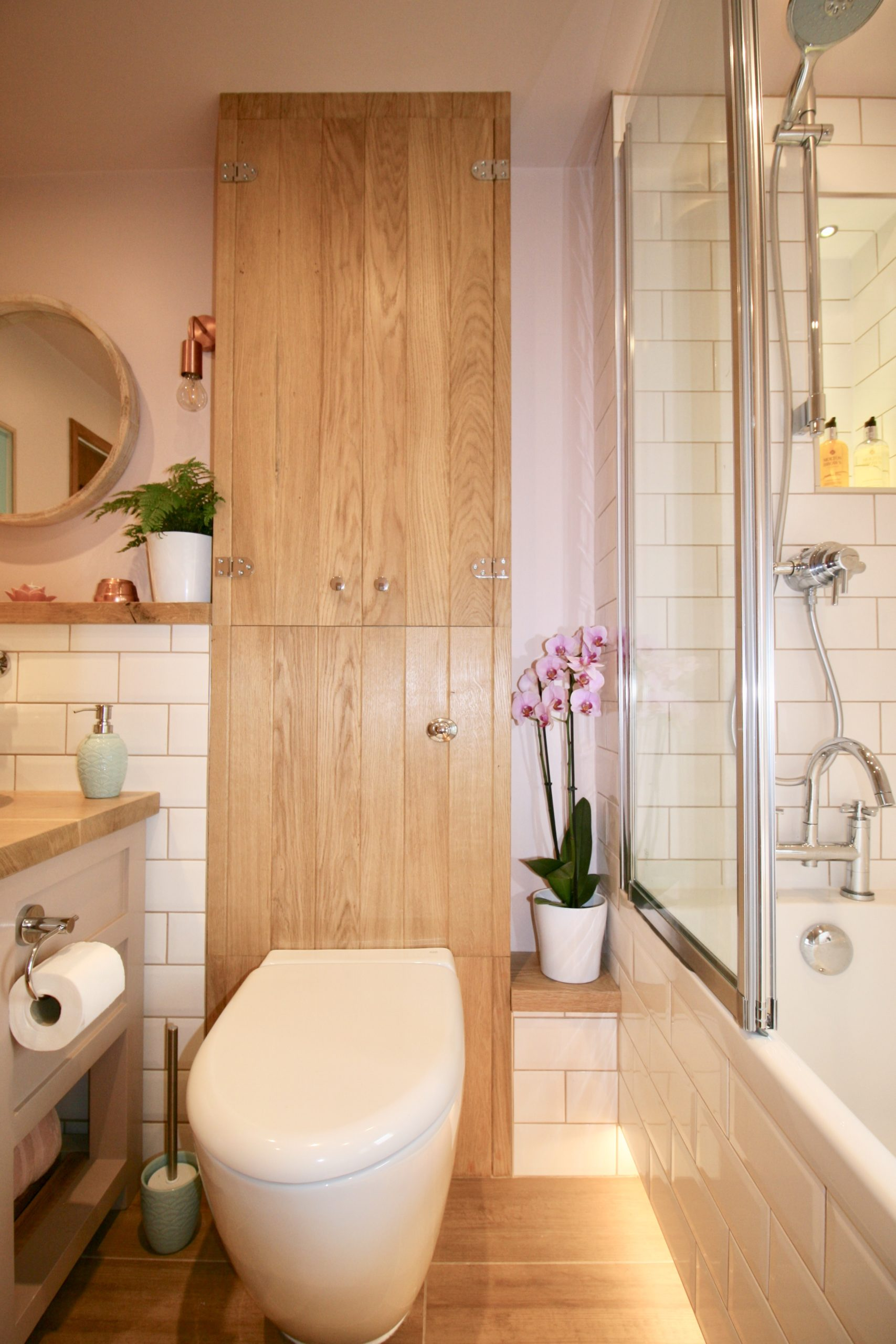 Bathrooms - Custom built oak cupboard in bathroom designed by Amelia Wilson Interiors
