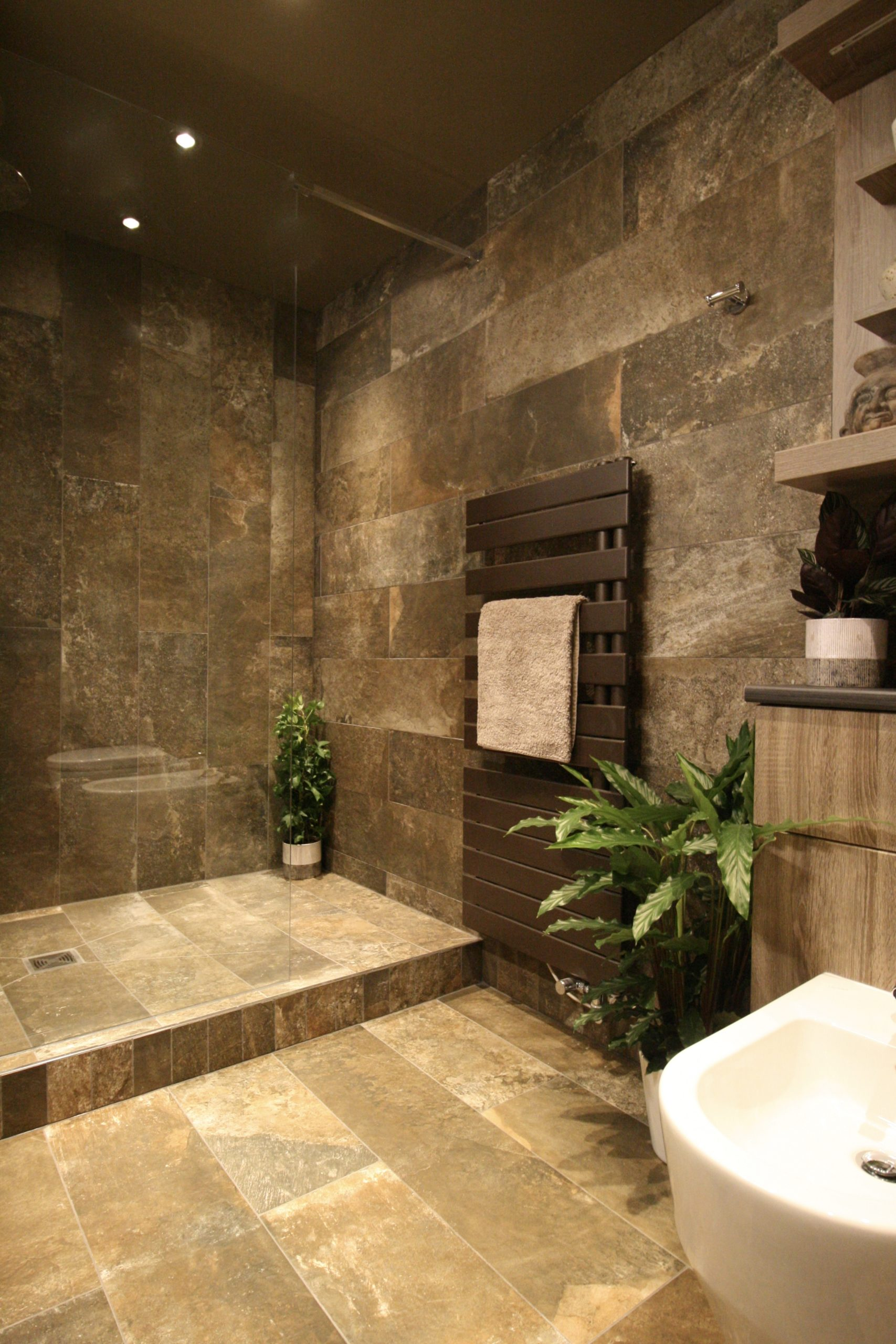 Contemporary bathroom with stone effect tiles