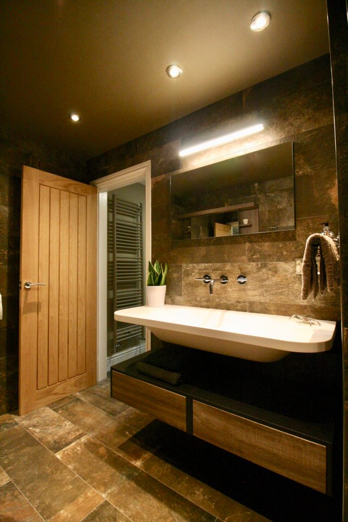 Luxury shower room bathroom with floating sink and under sink storage