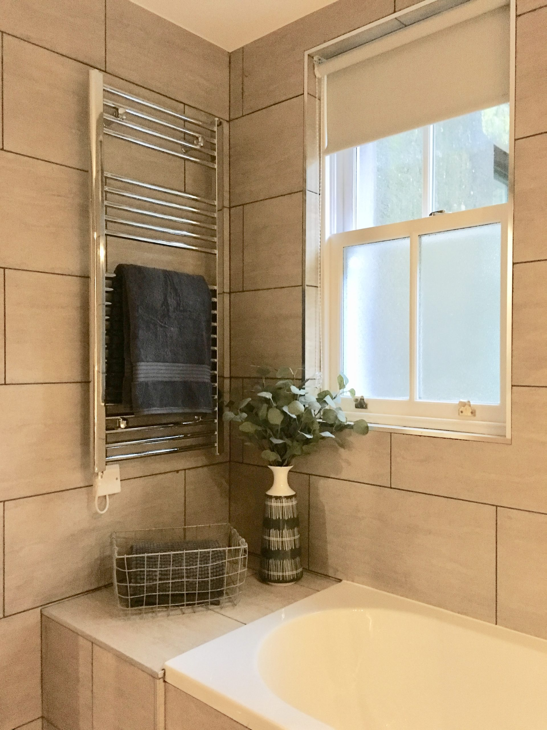 Bathroom styling and bathroom accessories in show home designed by Amelia Wilson Interiors Ltd
