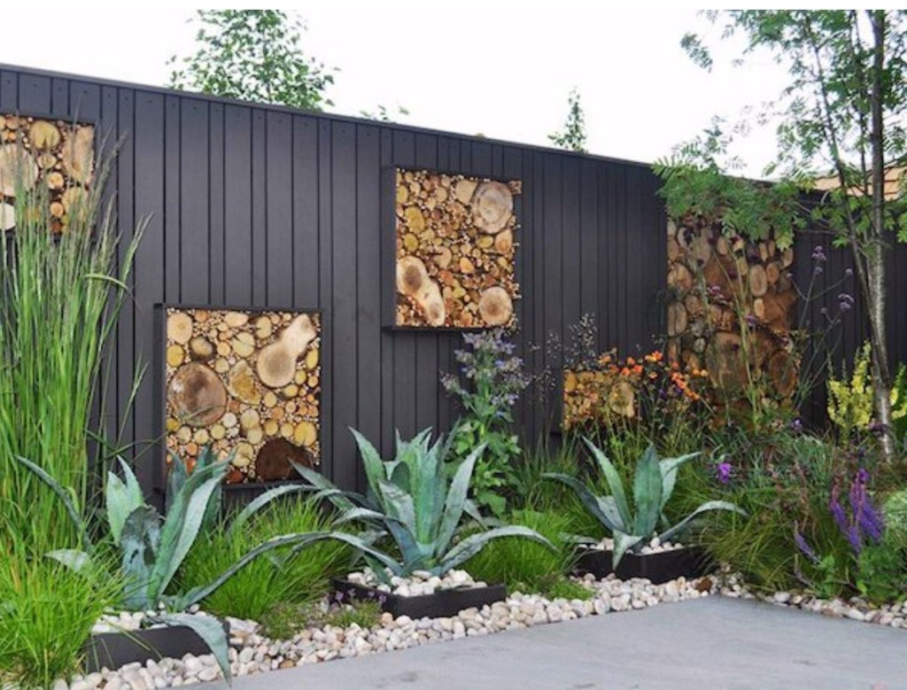 Modern garden design with custom log wall art
