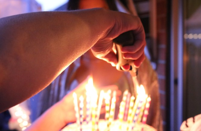 lighting candles on birthday cake