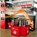 multiquad trade show booth display with magnetic graphic panels, counters and monitors