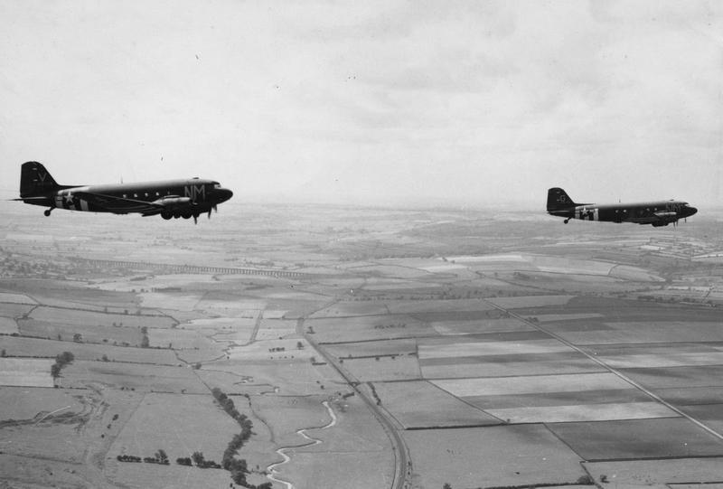 C-47 Skytrains of the 315th Troop Carrier Group in flight. Handwritten caption on reverse: 'C-47 Skytrain. 315 TCG over Lincolnshire. C-47 before 1944.'Image actually shows Harringworth Viaduct. RAF Spanhoe, the home field of the two Aircraft, is slightly out of shot to the left, making this right on the border of Rutland & Northamptonshire.