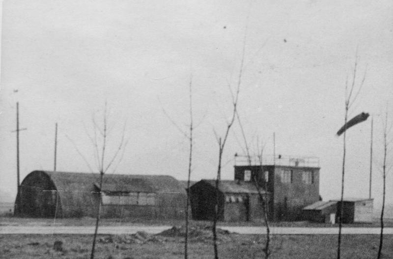 RAF Attlebridge, which became the home airfield of the 466th Bomb Group, earlier in the war when the RAF still owned the station. The control tower is to the left of the windsock. Handwritten caption on image: