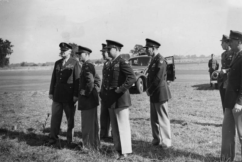 General Arnold with Colonel Frederick W Castle, Brigadier General Curtis LeMay, General Williams and General Anderson during a visit to Bury St Edmunds (Rougham), home of the 379th Bomb Group. Image stamped on reverse: 'Passed for publication 3 Sep 1943.' [stamp] nand '282085.' [censor no.] A printed caption was previously attached to the reverse however this has been removed. Associated news story: 'American Air Forces G.O.C. Meets The
