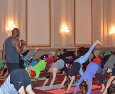 Keith Mitchell leading the yoga event on Capital. Photo via Congressional Yogi Association