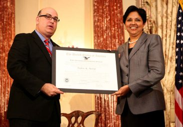 "USCIS Director Emilio T. González presents Indra K. Nooyi with the ""Outstanding American by Choice"" recognition in Washington, DC, Apr. 23, 2007"