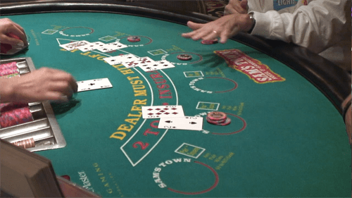 """How to play Blackjack: """"Stand"""" signal"""