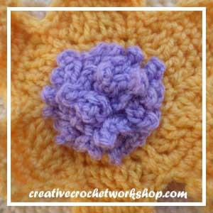 The Rapunzel Flower | Free Crochet Pattern | American Crochet @americancrochet.com @creativecrochetworkshop.com #freecrochetpattern