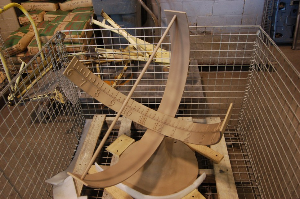A pair of sundials brought in for metal stripping