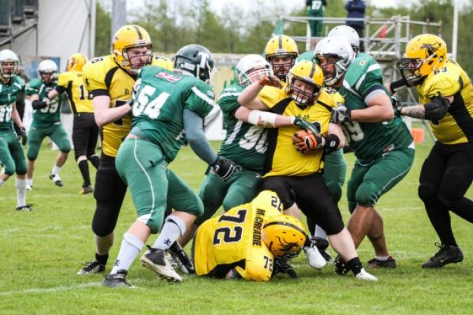 Trojans D gang tackle the ball carrier. Photo by Dave Bradshaw photography