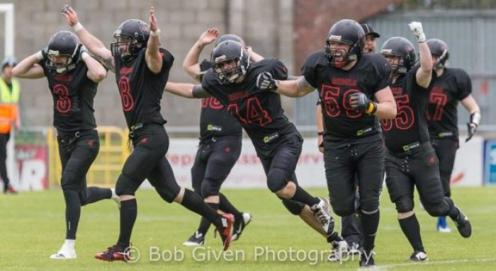 Rebels celebrate dramatic comeback. Photography by Bob Given.