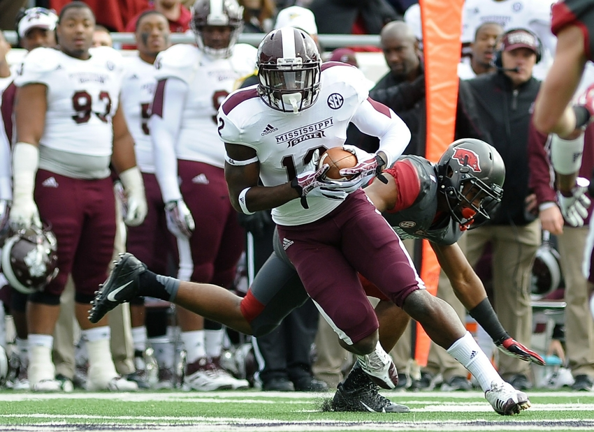 Nov 23, 2013; Little Rock, AR, USA; Mississippi State Bulldogs wide receiver Robert Johnson (12) carries the ball against the Arkansas Razorbacks during the second quarter at War Memorial Stadium. Mandatory Credit: Justin Ford-USA TODAY Sports