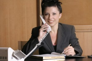 Orlando home inspection services a woman speaking on the phone and holding a pencil and a note
