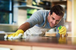 contractor man cleaning and spraying a flat space | American Home Services | Pest free home Orlando