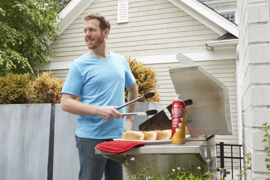 a man grilling | American Home Services | Kitchen Safety Tips Orlando