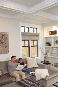 father and daughter reading in living room | American Home Services | carbon monoxide Orlando