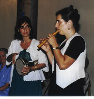 A piper and a drummer from Greece perform at an international conference in Graz, Austria