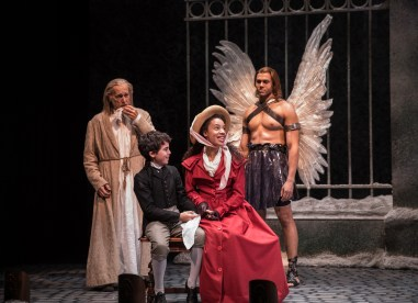"""A Christmas Carol,"" adapted by Tom Creamer from Charles Dickens, at Goodman Theatre in Chicago through Dec. 31. Pictured: Larry Yando, Aaron Lamm, Emma Ladji, and Travis A. Knight."