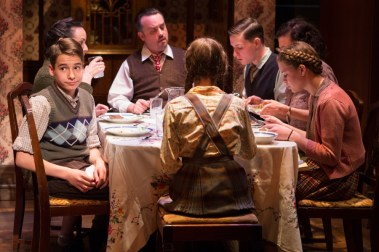 """Brighton Beach Memoirs"" by Neil Simon, at Theater J in Washington, D.C., in 2017. Pictured: Cole Sitilides, Susan Rome, Michael Glenn, Eli Pendry, Lise Bruneau, Marie-Josée Bourelly, and Sarah Kathryn Makl. (Photo by Teresa Wood)"