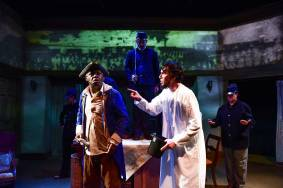 """""""The Heavens Are Hung in Black"""" by James Still, presented by Shattered Globe Theatre at Theater Wit in Chicago, through Oct. 21. Pictured: Darren Jones, Lawrence Grimm, and cast. (Photo by Evan Hanover)"""