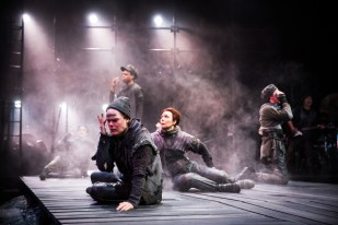 """""""Tug of War: Foreign Fire,"""" adapted by Barbara Gaines from Shakespeare, at Chicago Shakespeare Theater through June 12. Pictured: Alex Weisman, Daniel Kyri, Barbara Robertson, and cast. (Photo by Liz Lauren)"""