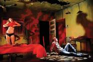 """Jennifer Blagan and Terry Hempleman in """"Fool for Love"""" by Sam Shepard at the Jungle Theater. (Photo by Michal Daniel)"""