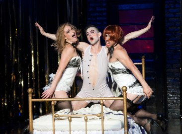 """""""Cabaret,"""" with a book by John Van Druten, adapted from stories by Christopher Isherwood, music by John Kander and lyrics by Fred Ebb, at the Signature Theatre in Arlington, Va., through June 28. Pictured: Colleen Hayes, Wesley Taylor and Mark Chandler. (Photo by Margot Schulman)"""