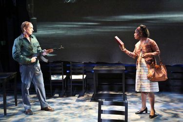 """""""The Best of Enemies,"""" adapted by Mark St. Germain from Osha Gray Davidson, at the Colony Theatre Company in Burbank, Calif., through Oct. 18. Pictured: Larry Cedar, and Tiffany Rebecca Royale. (Photo by Michael Lamont)"""