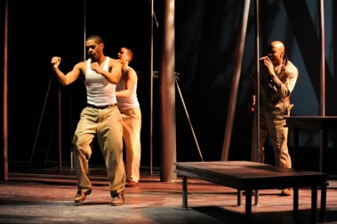 """""""The Brothers Size"""" by Tarell Alvin McCraney, at Curious Theatre Company in Denver, Colo., through Aug. 1. Pictured: Laurence Curry, Damion Hoover, and Cajardo Lindsey."""
