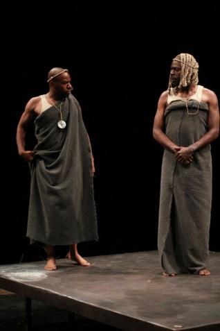 """""""The Island"""" by Athol Fugard, John Kani, and Winston Ntshona, at American Players Theatre in Spring Green, Wis., through Sept. 26. Pictured: La Shawn Banks and Chiké Johnson. (Photo by Carissa Dixon)"""