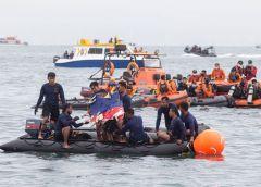 Indonesian Navy divers locate the wreckage of Sriwijaya Air flight SJ182 in the waters off Jakarta coast.