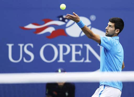 Novak Djokovic, of Serbia, serves to Stan Wawrinka, of Switzerland, during the men's singles final of the U.S. Open tennis tournament, Sunday, Sept. 11, 2016, in New York. (AP Photo/Charles Krupa)