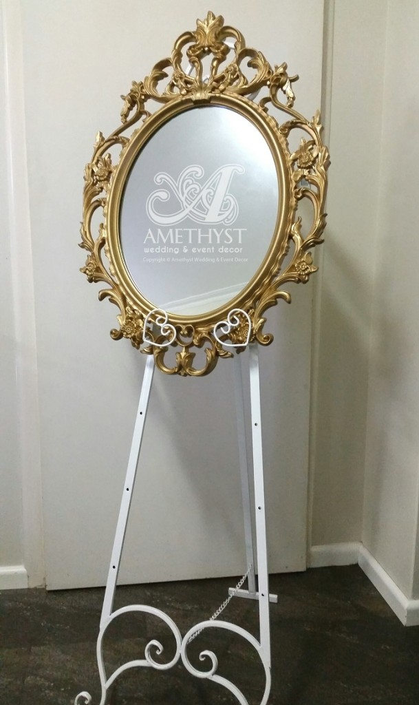 gold oval mirror easel