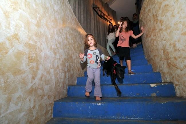 Children in bomb shelter at Kibbutz Kerem Shalom