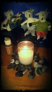 Imbolc candle and some goat friends