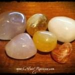 From top left: lithium quartz, citrine, pink calcite, rose quartz, orange calcite, sunstone