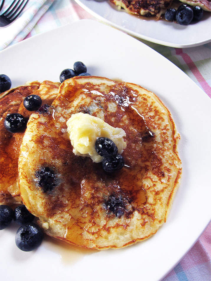 Light and fluffy Blueberry Cream Cheese Pancakes from Cravings: Hungry for More by Chrissy Teigen.