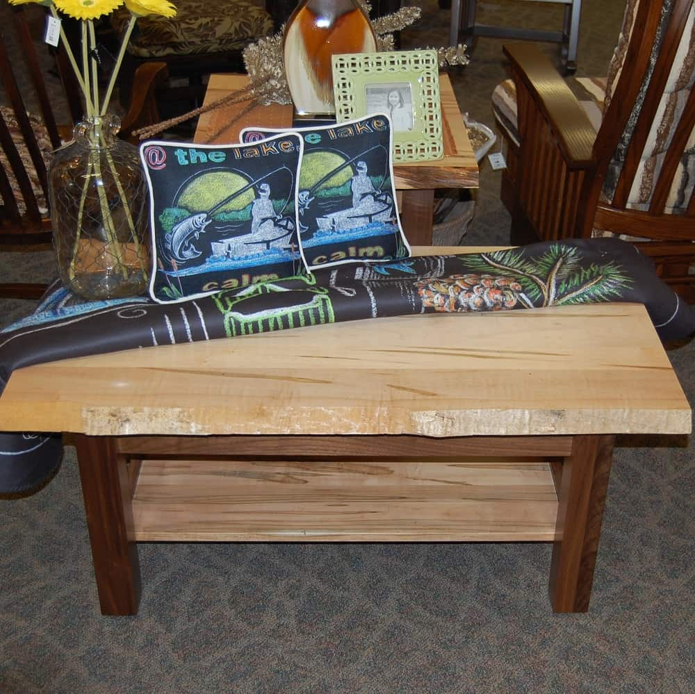 settler s coffee table shown with a live edge wormy maple top and shelf with rustic walnut legs done in a natural stain